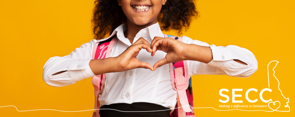 Photo of Girl with SECC logo and hands forming a heart
